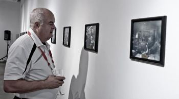 A patron views some of the Darling historical photos that are on display in a special exhibit (Image: Armstrong Fluid Technology)