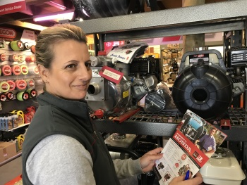 Honda dealer Hempfield Small Motor's Kristina Carr takes a look at Aussie Pumps new Powered By Honda Brochure (Image: Aussie Pumps)