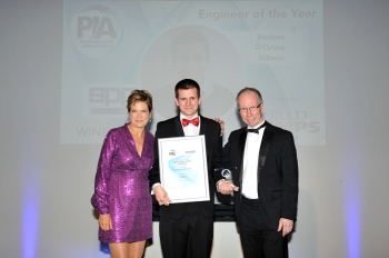 Engineer of the Year Winner - Reuben d Orton-Gibson - SPP Pumps - receiving his award from Host, Penny Smith, and Sponsor, Alan Burrows, World Pumps. (Image: BPMA)